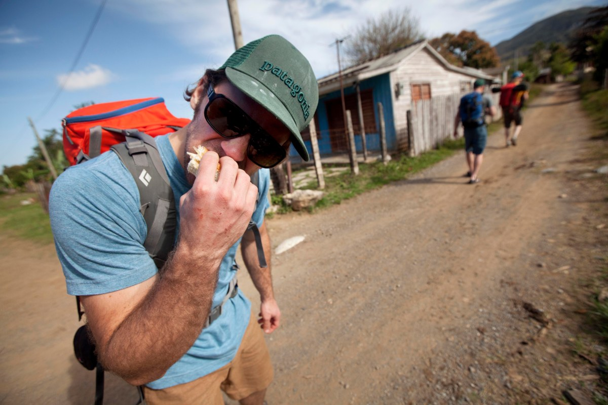 Climber eating cheese sandwich in small village of Cuba before heading to the crag.